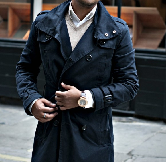 fiddling-with-hands-and-gold-watch-double-breasted-navy-trench-coat-jacket