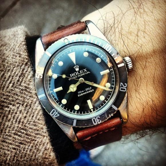 Rolex Submariner vintage James Bond watch under tweed herringbone coat