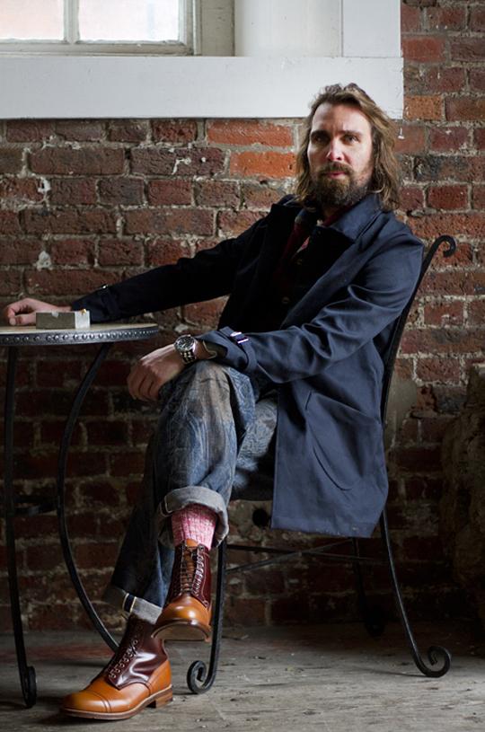 Sitting, cuffed jeans, wool socks & Grenson cap toe boot