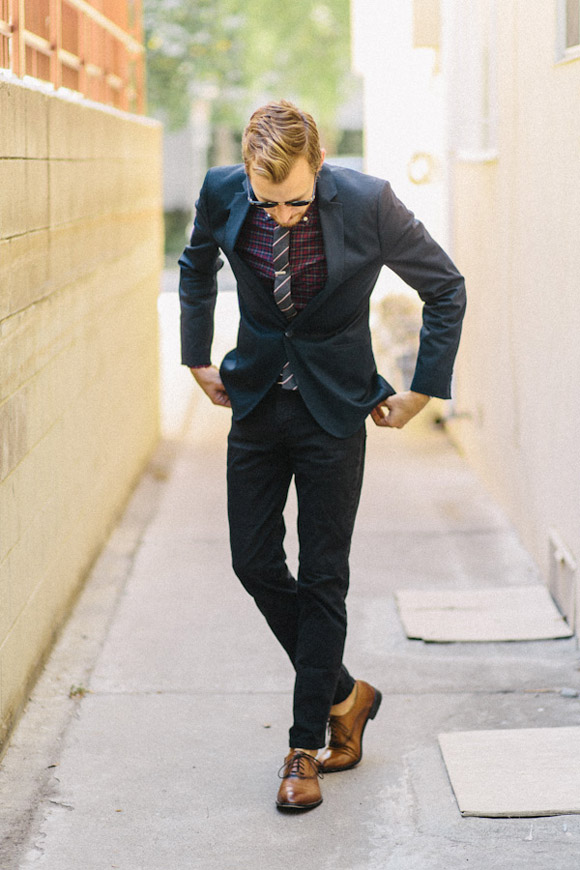 Slim cut navy suit going no socks & brown oxford shoes