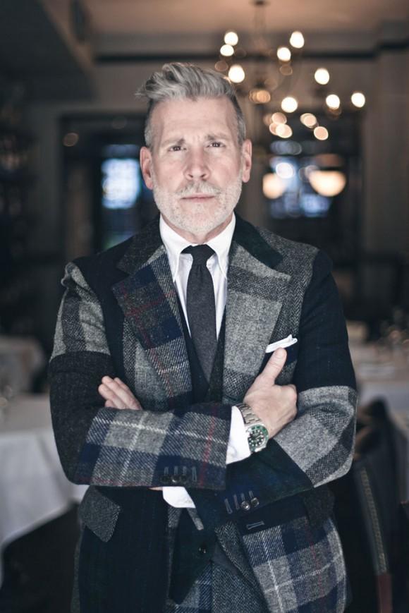 nick-wooster-grey-plaid-tweed-three-piece-suit-wool-tie-white-pocket-square-arms-crossed