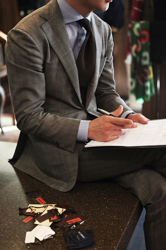 Legs Crossed While Writing in Classy Grey Suit - Glen Plaid Fabric Pattern