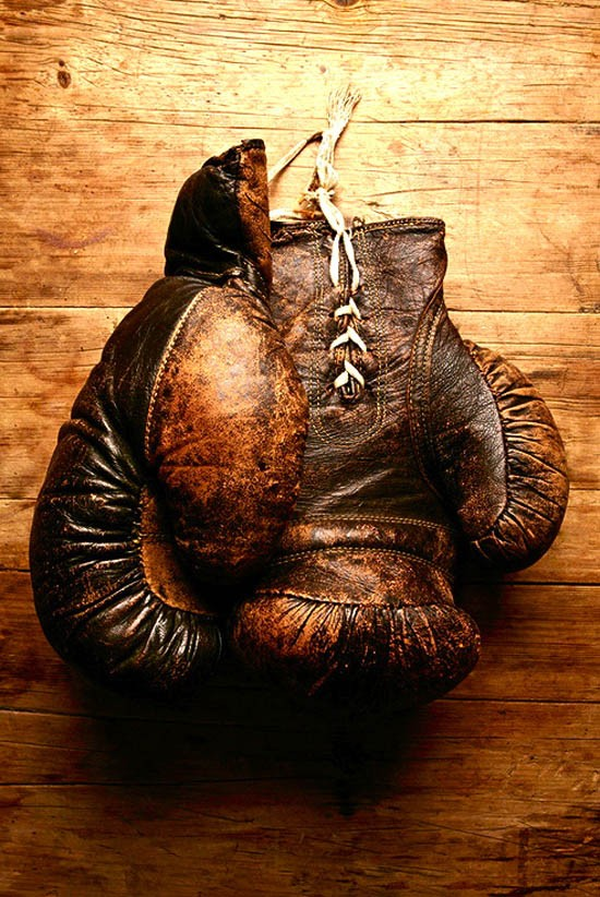 Worn out beat up gloves tell a story of violence, Mike Tyson