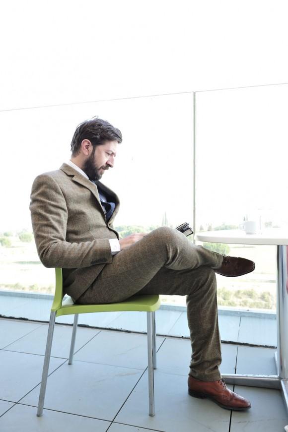 Seated Gentleman Windowpane Herringbone suit Brown shoes