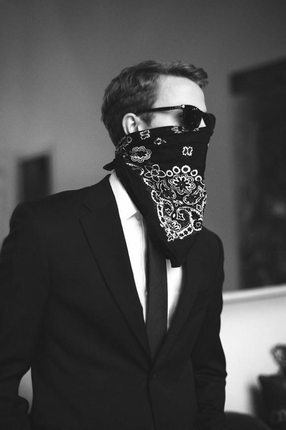 Dapper bandit wearing paisley bandana suit sunglasses