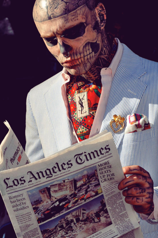 His real name is rick genest but goes by the alias zombie boy for