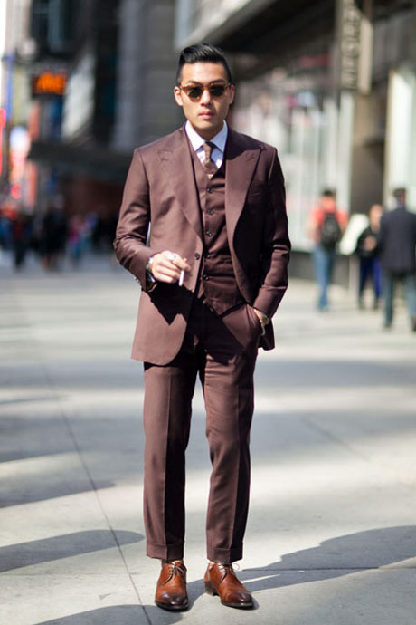 3 Piece Suit Holding The Socks 1
