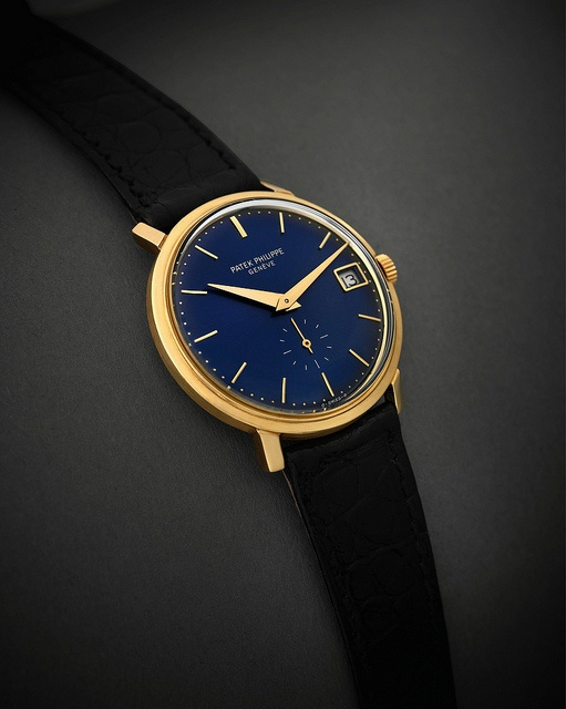 Incredisleek Patek Philippe gold blue watch