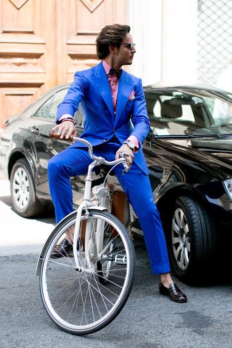 Bright Blue Suit on Bike