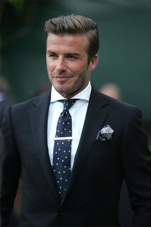 David Beckham in a suit playing soccer. There is a reason it is called