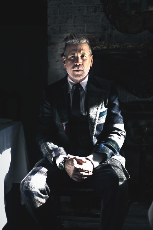 Nick Wooster in the Shadows hands clasped