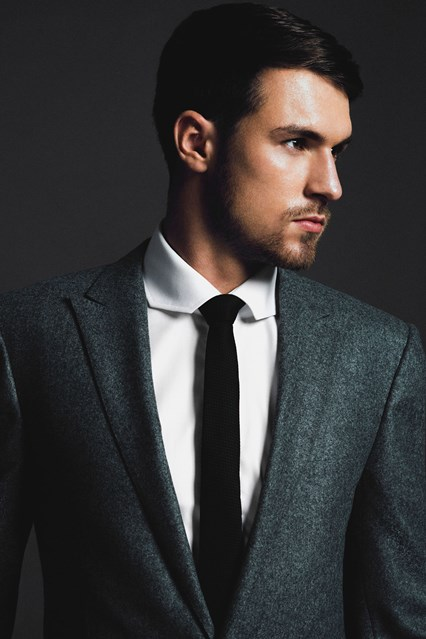 Thin peaked lapel modern suit Aaron Ramsey for GQ
