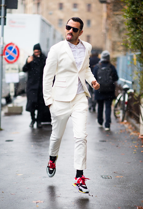 White Suit & Sneakers Tongue Out streetstyle