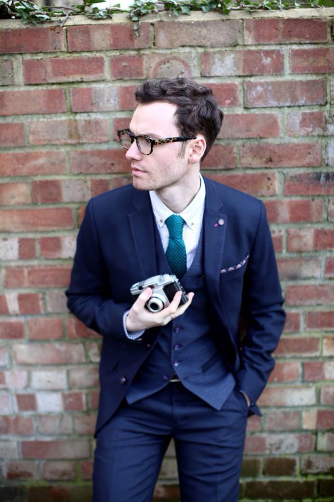 Dapper Photographer wearing leopard print frames