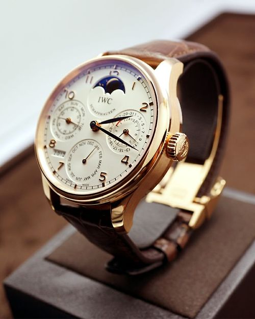 IWC chronograph watch white face leather strap