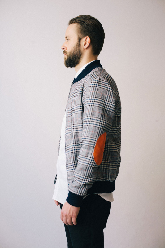 Blanket Plaid Varsity Jacket with an elbow patch