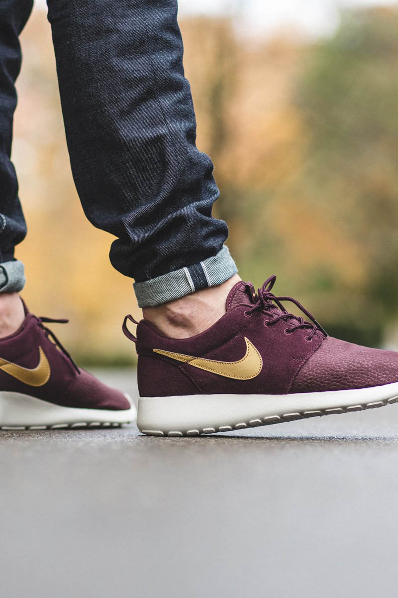 NIKE Roshe One in #mahogany suede uppers, a white midsole & a #metallic swoosh. #premium #sneakers